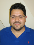 Headshot of Adrian Suarez-Delgado